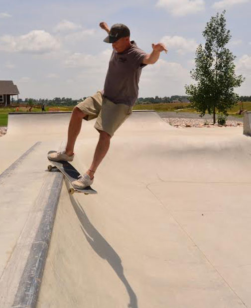 Kevin getting a smooth smith grind.
