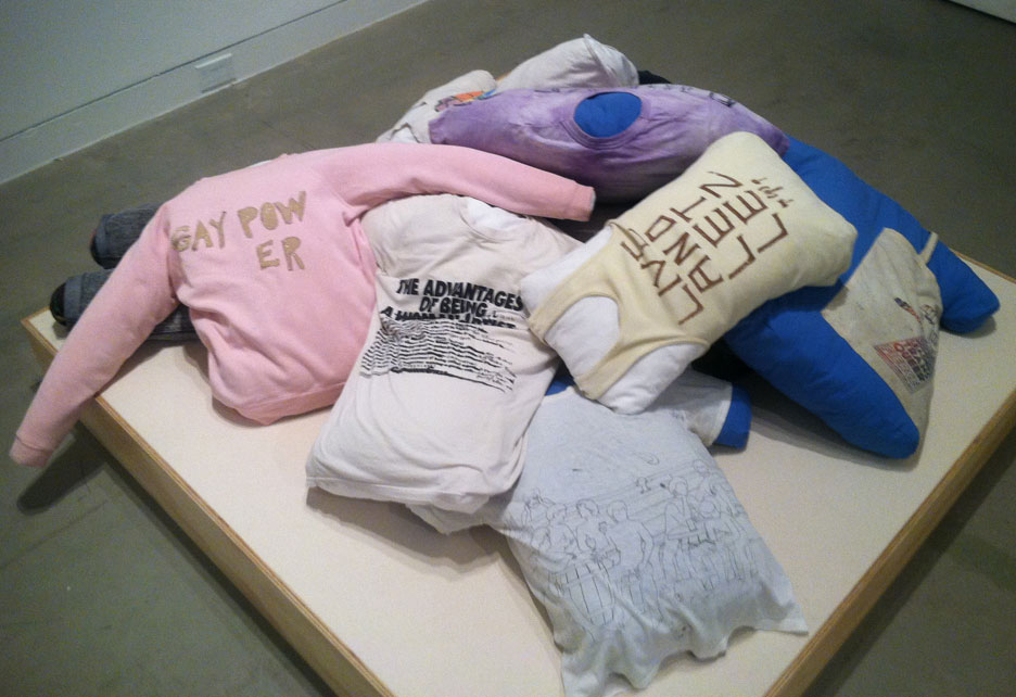 Pillow exhibit made from pro women slogan themed clothing
