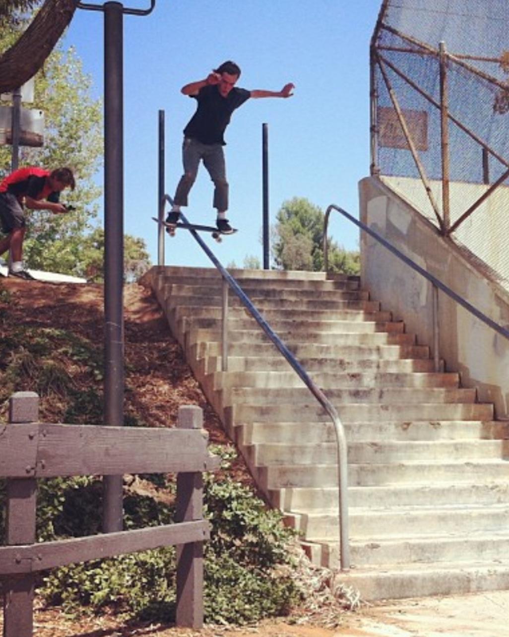 Chris Center Vegetableshredder vegan skateboarder board slide stair case hand rail